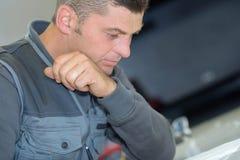 Portrait handsome worker in factory Stock Photos