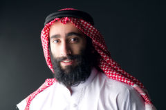 Portrait of a handsome young arabian man with a bushy beard Royalty Free Stock Images