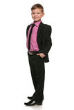 Handsome young boy in black suit Royalty Free Stock Images