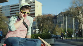 Portrait of a handsome young boy talking on phone, outdoors. stock footage