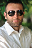 Portrait of a handsome young business man with sunglasses Stock Image