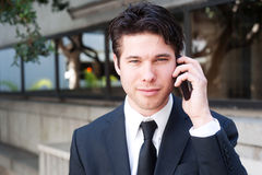 Portrait of handsome, young business man using cell Stock Photography