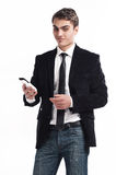 Young happy man holding mobile phone. Portrait of handsome young business man using cell phone, smiling Royalty Free Stock Image