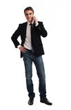 Young happy man holding mobile phone. Portrait of handsome young business man using cell phone, smiling Stock Photo