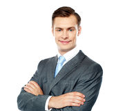 Portrait of handsome young businessman. Posing with crossed arms against white background Royalty Free Stock Photos