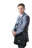 Portrait of a handsome young businessman with bag in suit isolated royalty free stock images