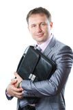 Portrait of a handsome young businessman with bag in suit isolated on white royalty free stock photos