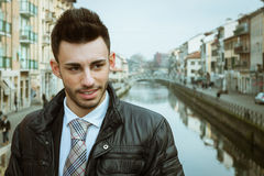 Portrait of a handsome young businessman on a bridge Royalty Free Stock Photo