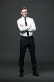 Portrait of handsome young businessman on dark background. Stock Photography