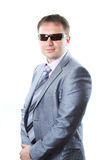 Portrait of a handsome young  businessman in glasses in suit isolated Royalty Free Stock Photos