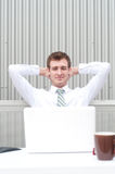 Portrait of a handsome young businessman relaxing Royalty Free Stock Photo