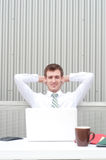 Portrait of a handsome young businessman relaxing Royalty Free Stock Image