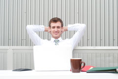 Portrait of a handsome young businessman relaxing Royalty Free Stock Photos