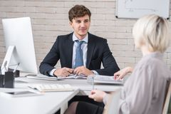 Handsome Man in Important Business Meeting stock photo