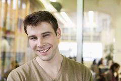 Portrait of handsome young businessman smiling in office Royalty Free Stock Photo