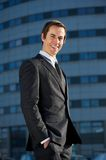 Portrait of a handsome young businessman smiling outdoors Stock Images