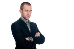 Portrait of a handsome young businessman staring against. Isolated white background Royalty Free Stock Image