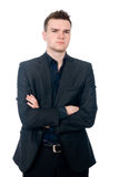 Portrait of a handsome young businessman staring against. Isolated white background Stock Image