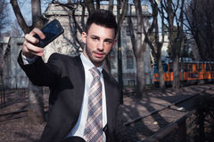 Portrait of a handsome young businessman taking a selfie Royalty Free Stock Photography