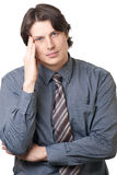 Portrait of handsome young businessman thinking Royalty Free Stock Image