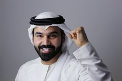 Portrait Of A Very Confident Arab Emirati Man Happy Smiling And Wearing UAE Traditional Dress
