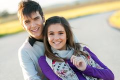 Portrait of handsome young couple in countryside. stock image