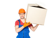 Handsome young delivery man with paper boxes Stock Photo