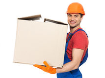 Handsome young delivery man with paper boxes Stock Photography