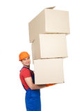 Handsome young delivery man with paper boxes Royalty Free Stock Image