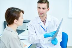 Doctor Holding X-Ray Image royalty free stock image