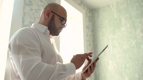 Portrait Of A Handsome Young Happy Man Using Digital Tablet. Slow-motion stock video footage