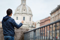 Portrait of a handsome, young, male tourist in Rome, Italy. (dome of the Santissimo Nome di Maria church in the background Royalty Free Stock Photography
