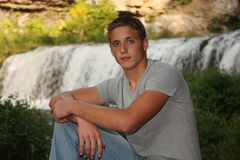 Portrait of Handsome Young Man. Casual outdoor portrait of serious young man by a waterfall Royalty Free Stock Photos