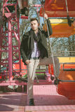 Portrait of a handsome young man on amusement ride Stock Images