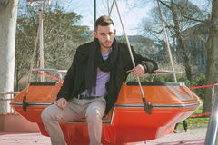 Portrait of a handsome young man on amusement ride Royalty Free Stock Image