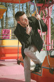 Portrait of a handsome young man on amusement ride Royalty Free Stock Photography