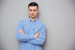 Portrait of a handsome young man with arms folded Stock Image