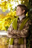 Portrait of handsome young man in autumn park Stock Photo