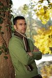 Portrait of handsome young man in autumn park Royalty Free Stock Photo