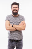 Portrait handsome young man with beard with crossed hands smiling Stock Photography
