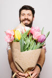 Portrait Handsome young man with beard  and nice bouquet of flowers Royalty Free Stock Photos