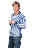 Handsome Young Man Buttoning his Shirt Royalty Free Stock Photos