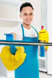 Man cleaning the house Stock Image