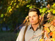 Portrait of handsome young man  in fall (autumn). Portrait of attractive guy outdoors during fall, at sunset Royalty Free Stock Photography