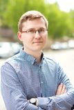 Portrait of handsome young man in glasses outdoor Royalty Free Stock Photo