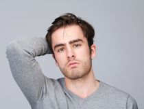 Portrait of a handsome young man with hand in hair Royalty Free Stock Photos