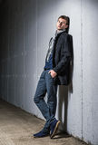 Portrait of handsome young man in jeans and coat Royalty Free Stock Image