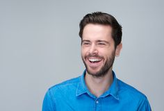 Portrait of a handsome young man laughing Stock Photography