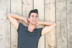 Portrait of a handsome young man laughing outdoors Royalty Free Stock Image