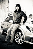 Portrait of handsome young man leaning to car hood Stock Photography